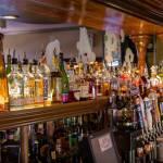 Caps behind the bar